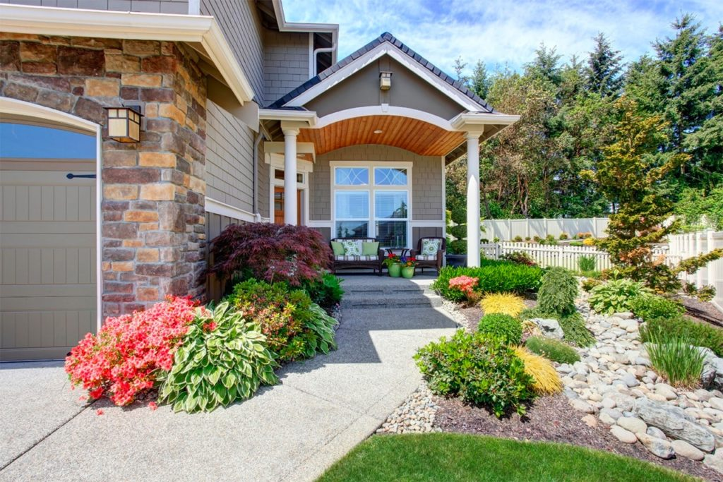 Curb appeal with mulch and rock beds